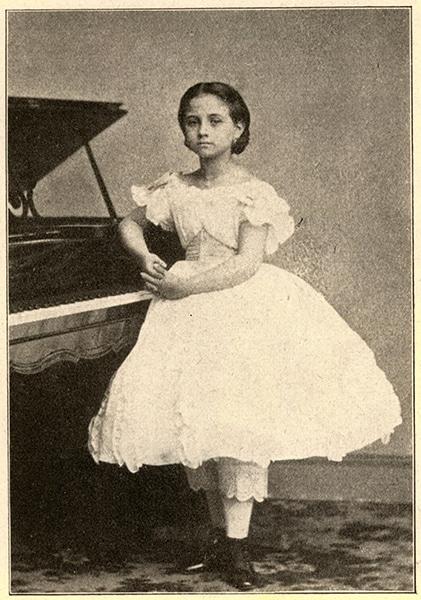 TERESA CARREÑO, AGE 8, AT THE PIANO.