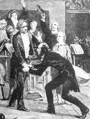 Paganini throwing himself at Berlioz's feet.