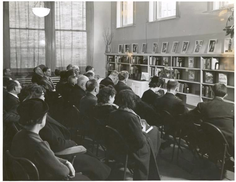 A group of opera lovers listens to a radio broadcast at the library•PhotoNew York Public Library (Public Domain)