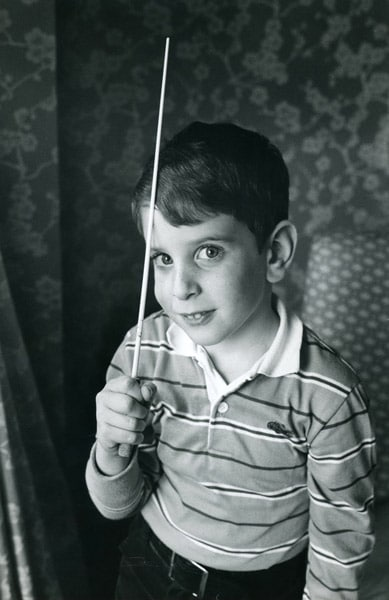 Alan Pierson, age six, posing with George Solti's baton • Photo Courtesy of Alan Pierson