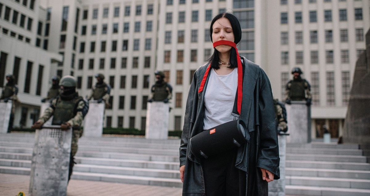 Protester in Minsk, Belarus with a red sash tied around her mouth